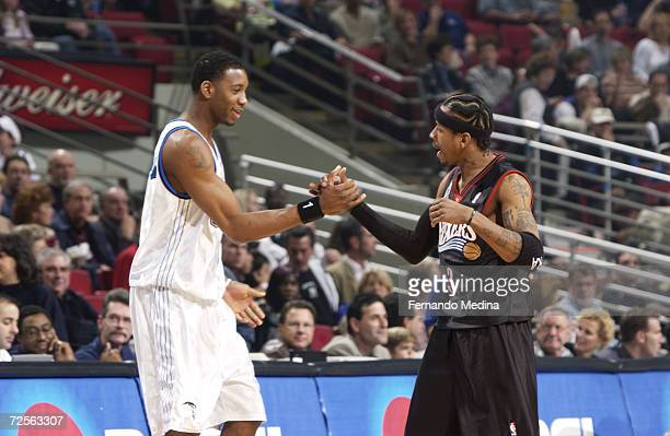 Tracy McGrady the Orlando Magic and Allen Iverson of the Philadelphia 76ers shake hands before the game at TD Waterhouse Centre in Orlando Florida...