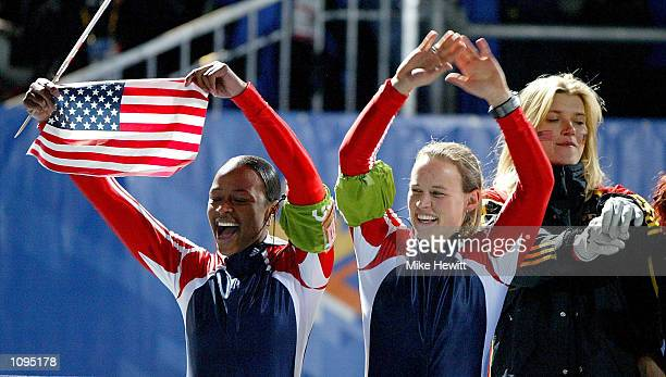USA 2 Jill Bakken and Vonetta Flowers celebrate after winning the gold medal in the women's 2woman bobsled during the Salt Lake City Winter Olympic...