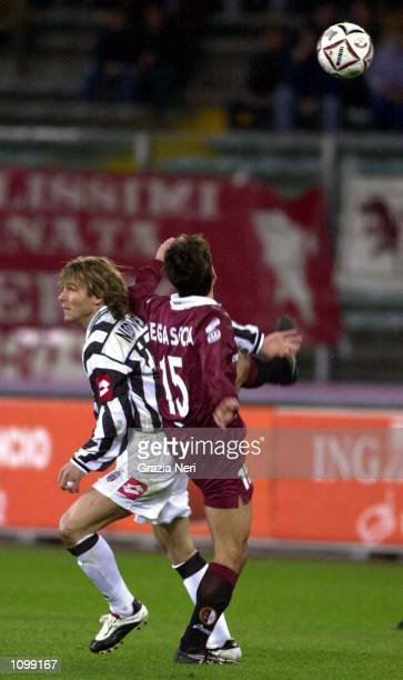 Vergassola of Torino and Pavel Nedved of Juventus in action during the Serie A League match between Torino and Juventus at the Delle Alpi Stadium...