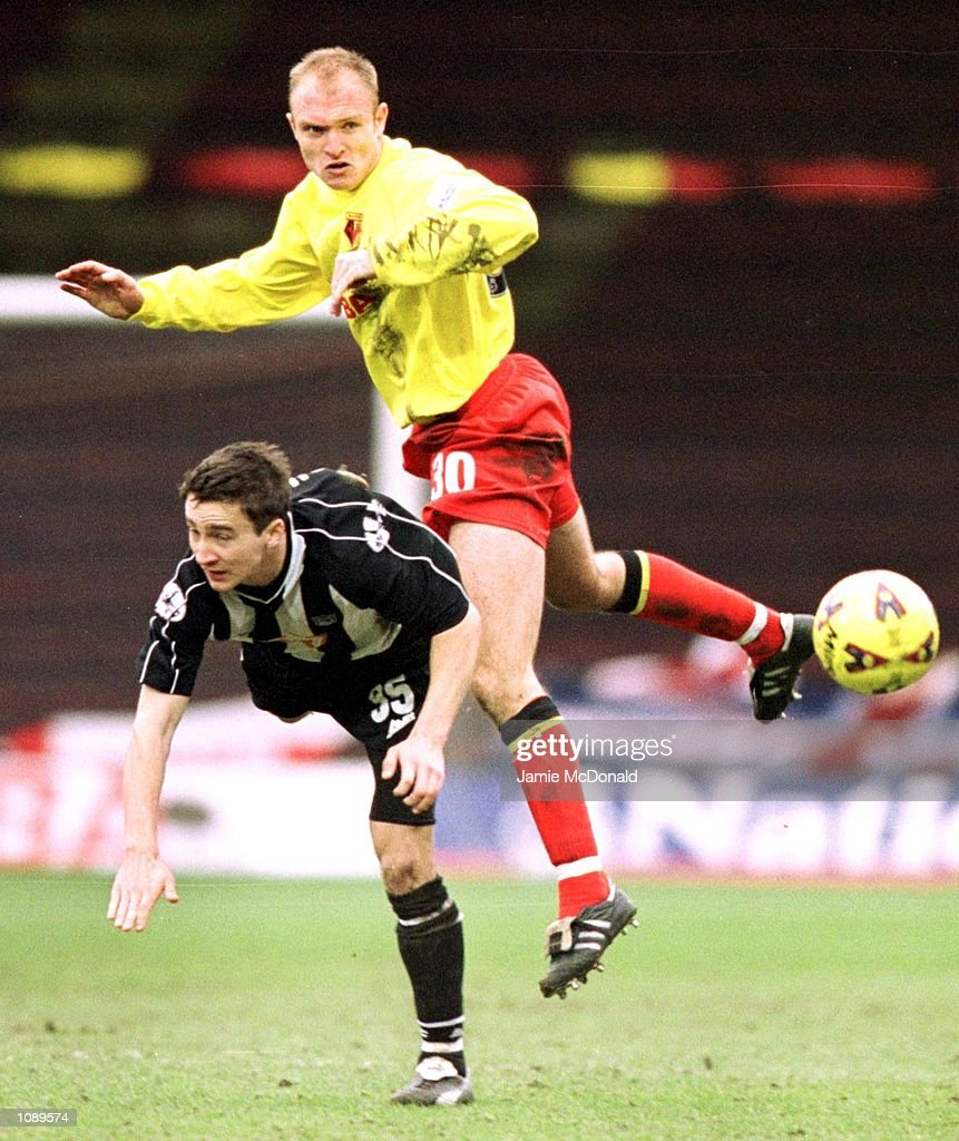 Wayne Brown of Watford tussles with Michael Boulding of Grimsby during the Nationwide League Division One game between Watford v Grimsby Town at Vicarage Road Stadium, Watford. Mandatory Credit: Jamie McDonald/Getty Images