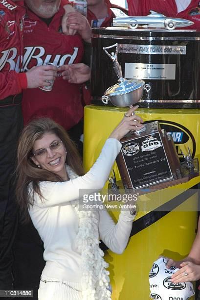 Theresa Earnhardt holds up the trophy after her son Dale Earnhardt Jr wins the Daytona 500 at Daytona International Speedway in Daytona Beach FL
