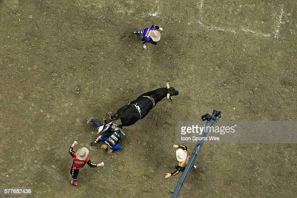 Emilio Resende dismounts off High Tinsle during the Professional Bull Riders