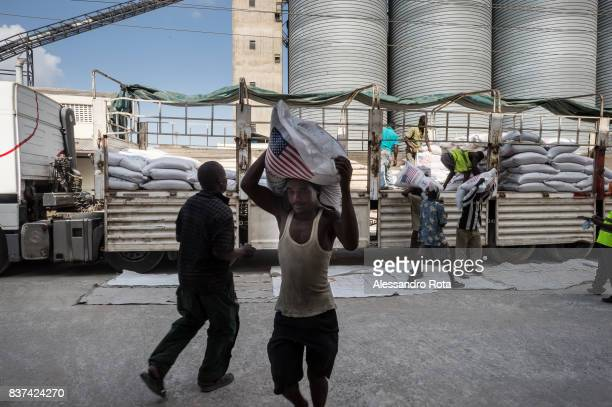 Feb 2015. Mombasa . Daily tasks at the World Food Program facility inside the port. Raw cereals bought by WFP on the worldwide market is transported...