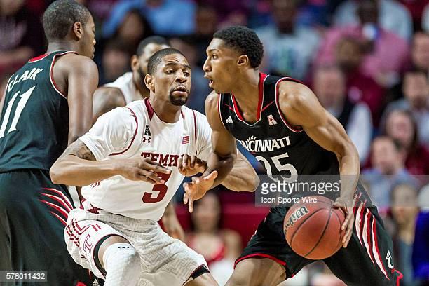 Temple Owls guard Jesse Morgan defends against Cincinnati Bearcats guard Kevin Johnson during the NCAA men's basketball game between the Cincinnati...