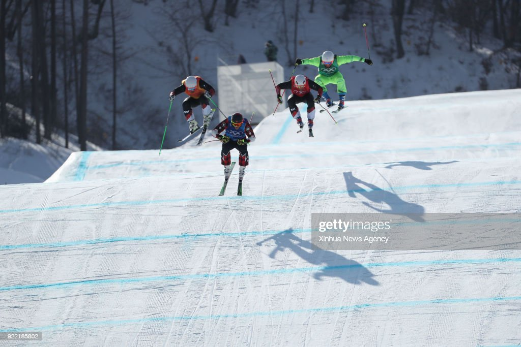 PYEONGCHANG, Feb. 21, 2018 -- Athletes compete during the men's ski cross semifinal of freestyle skiing at the 2018 PyeongChang Winter Olympic Games, at Phoenix Snow Park, in PyeongChang, South Korea, on Feb. 21, 2018.