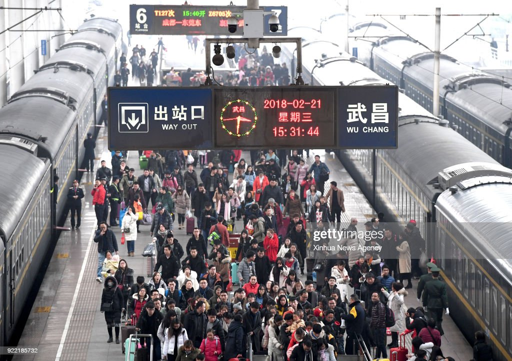 WUHAN, Feb. 21, 2018 -- Passengers are seen at the Wuchang Railway Station in Wuhan, central China's Hubei Province, Feb. 21, 2018. On the last day of the Spring Festival holiday, China greets a travel peak for returning to workplace.