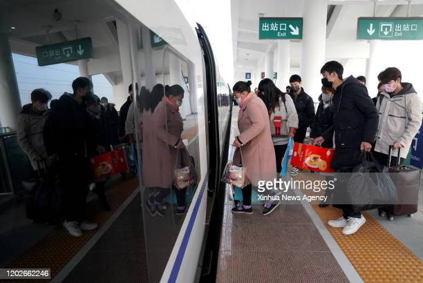 Feb. 22, 2020 -- People board a customized train heading for east China's Zhejiang Province at Zhoukou East Railway Station in Zhoukou, central...