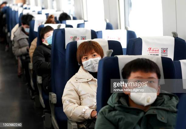 Feb. 22, 2020 -- People take a customized train heading for east China's Zhejiang Province, Feb. 22, 2020. More than 700 passengers from central...