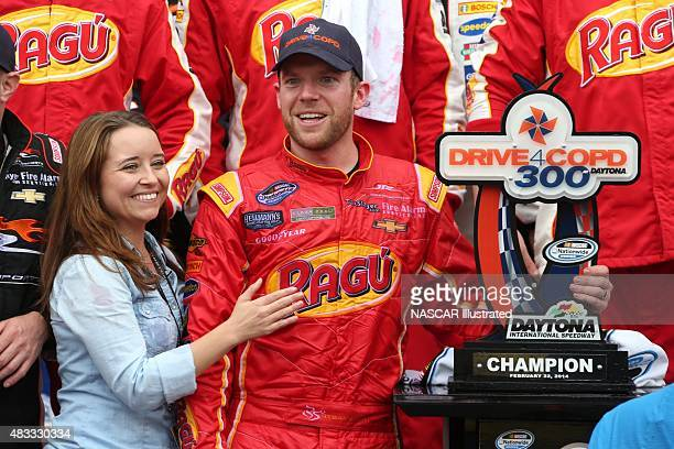 Regan Smith driver of the Ragu Chevy Camaro celebrates with his wife Megan Mayhew in victory lane after winning the NASCAR Nationwide Series...