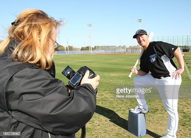 Feb 23 2009 Jesse Litsch pulls a fast one on Topps baseball cards photographer Nancy Scariati as he gets his card taken with a bat even though he is...
