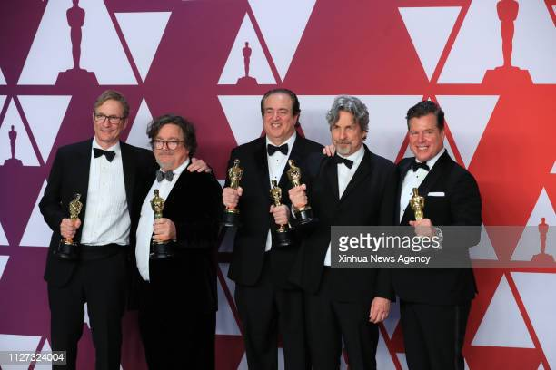 LOS ANGELES Feb 25 2019 Cast members of the Green Book pose for photos after winning the Best Picture award in the press room during the 91st Academy...
