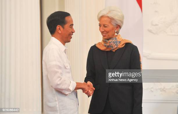 JAKARTA Feb 26 2018 Indonesian President Joko Widodo shakes hands with Christine Lagarde managing director of the International Monetary Fund during...