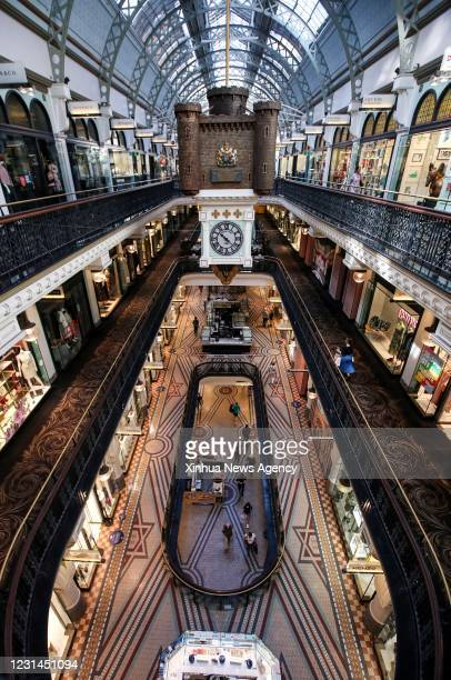 Feb. 26, 2021 -- People walk in a shopping center in Sydney, Australia, on Feb. 26, 2021. Restrictions in the Australian state of New South Wales NSW...
