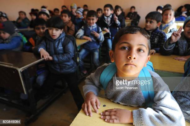 Feb. 26: Classrooms overflow at the Al Muthanna Primary School in eastern Mosul as school resumes after nearly three years of Islamic State rule and...