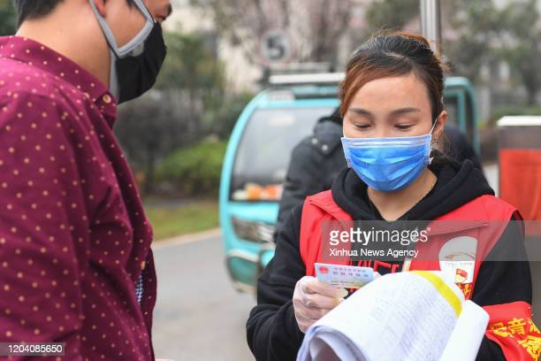 Feb. 28, 2020. Li Wei R checks the information of a man entering the community in Changsha, central China's Hunan Province, . Li Wei, a 39 year-old...