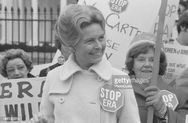 Feb 4 1977 Activist Phyllis Schafly wearing a Stop ERA badge demonstrating with other women against the Equal Rights Amendment in front of the White...