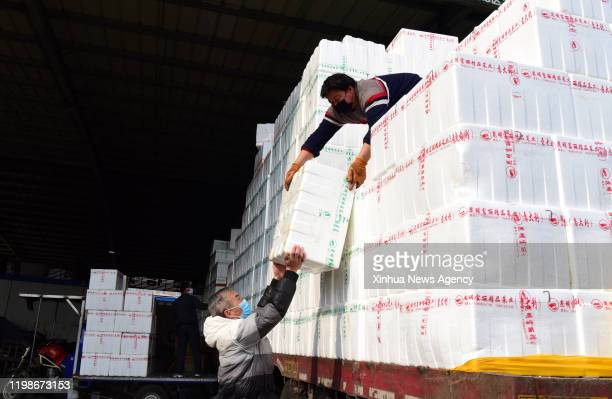 Feb. 4, 2020 -- Workers unload vegetables at Wanbang wholesale market of agricultural products in Zhongmu County of Zhengzhou, central China's Henan...
