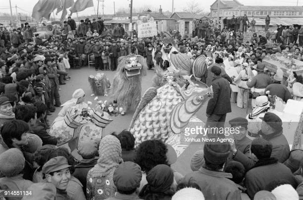 BEIJING Feb 5 2018 File photo taken in February 1985 shows a festive lantern troupe performing before the Spring Festival in Luokou Village of Jinan...