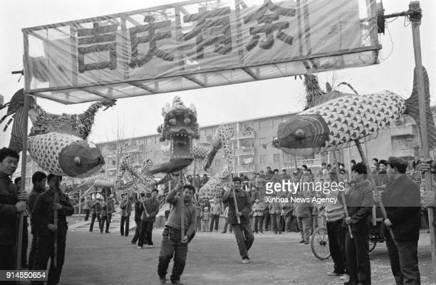 BEIJING Feb 5 2018 File photo taken in February 1985 shows villagers performing festive lanterns in Duandian Village of Jinan City east China's...