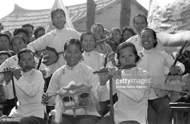 BEIJING Feb 5 2018 File photo taken in January 1986 shows women performing with instruments to greet the Spring Festival in Yunwei Village of...