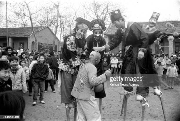 BEIJING Feb 5 2018 File photo taken in January 1992 shows folk artists exercising stilts in Linquan County of east China's Anhui Province In Chinese...
