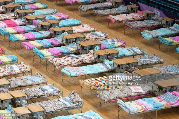 Feb. 5, 2020 -- Photo taken on Feb. 4, 2020 shows an interior view of the Hongshan Gymnasium, a venue converted into a makeshift hospital to receive...