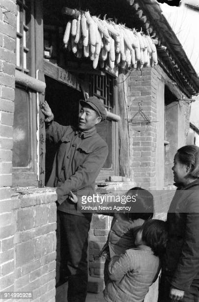 BEIJING Feb 6 2018 File photo taken in February 1984 shows family members stick Spring Festival couplets in Fengtai District of Beijing capital of...