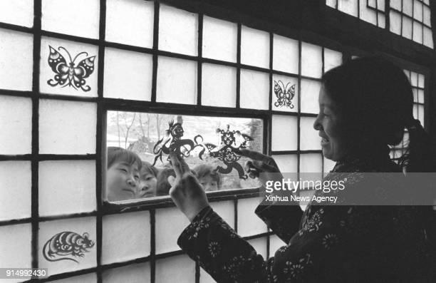 BEIJING Feb 6 2018 File photo taken in February 1989 shows a woman displaying her papercuttings in Xujiagou Village of Ansai County in Yan'an...