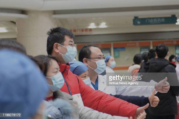 Feb. 7, 2020 -- Medical team members of the Xiangya Hospital of Central South University pose for photos before setting out for Hubei Province in...