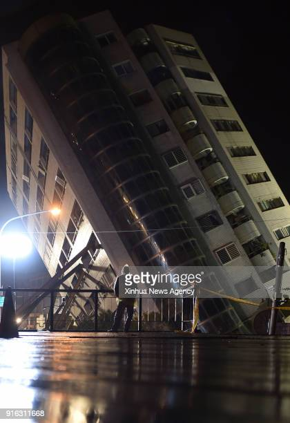 Feb. 8, 2018 : A citizen looks at the damaged Yun Men Tusi Ti building in Hualien, southeast China's Taiwan, Feb. 8, 2018. A powerful earthquake has...