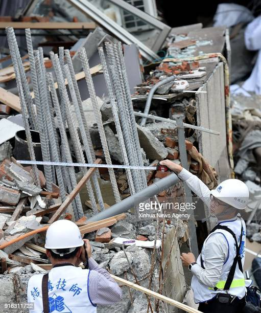 Feb. 9, 2018 : Technicians collect evidence by photos at the damaged Yun Men Tusi Ti building in Hualien County, southeast China's Taiwan, Feb. 9,...