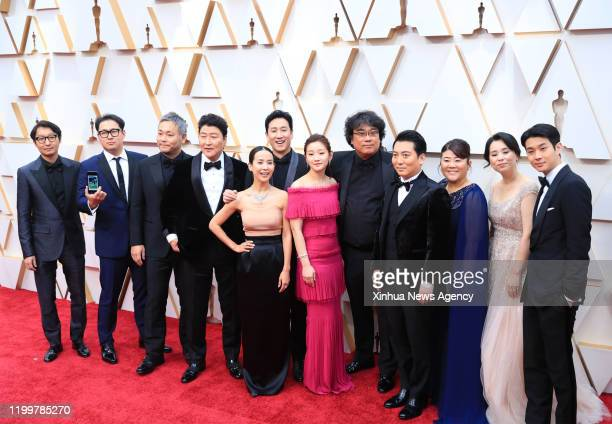 LOS ANGELES Feb 9 2020 Director Bong Joonho 5th R arrives with cast and crew members of Parasite for the red carpet of the 92nd Academy Awards at the...