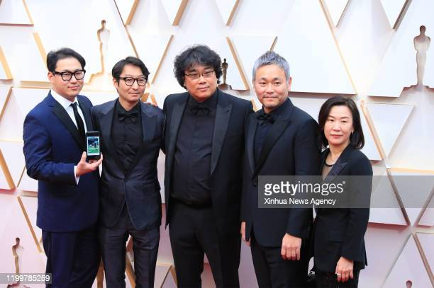 LOS ANGELES Feb 9 2020 Director Bong Joonho C arrives with cast and crew members of Parasite for the red carpet of the 92nd Academy Awards at the...