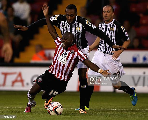 Febian Brandy of Sheffield United and Yoann Arquin of Notts County challenge for the ball during the Sky Bet League One match between Sheffield...