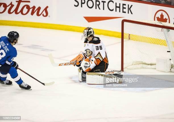 Winnipeg Jets forward Jack Roslovic scores on Anaheim Ducks goalie John Gibson during the regular season game between the Winnipeg Jets and the...