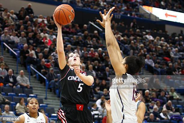 University of Cincinnati's Guard Makenzie Cann shoots over UConn's Guard Gabby Williams during an American Athletic Conference women's NCAA Division...