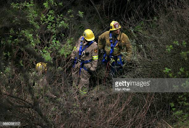 CITY CA February 05 2010 ––– Members of Los Angeles City Fire Urban Search and Rescue team Hollyn Bullock left Ray Rodriguez and Brad Ibanez looking...