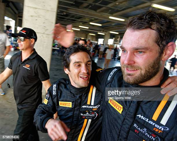 No 59 Tekno Autosport McLaren 650S GT3 drivers Alvaro Parente and Shane van Gisbergen celebrate their win following the LiquiMoly Bathurst 12 Hour at...