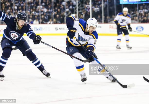 St Louis Blues forward Brayden Schenn skates away from Winnipeg Jets forward Patrik Laine during the NHL game between the Winnipeg Jets and the St...