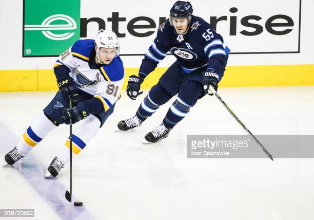 St Louis Blues forward Vladimir Tarasenko skates away from Winnipeg Jets forward Mark Scheifele during the NHL game between the Winnipeg Jets and the...