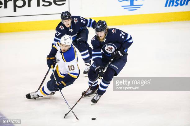 Winnipeg Jets forward Patrik Laine steals the puck from St Louis Blues forward Brayden Schenn during the NHL game between the Winnipeg Jets and the...