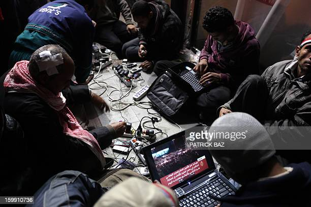 A February 10 2011 file photo shows Egyptian antigovernment bloggers work on their laptops from Cairo's Tahrir square on on the 17th day of...
