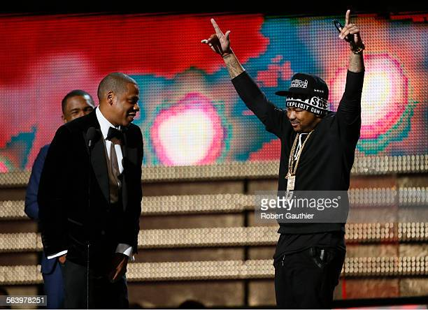 LOS ANGELES CA February 10 2013 JayZ front left comments on headgear worn by TheDream at the Grammys Frank Ocean is behind Jay Z_ at the 55th Annual...