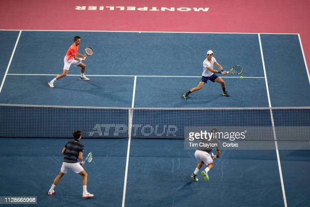 MONTPELLIER FRANCE February 10 Benjamin Bonz of France and Antoine Hoang of France in action against Ivan Dodig of Croatia and Edouard RogerVasselin...