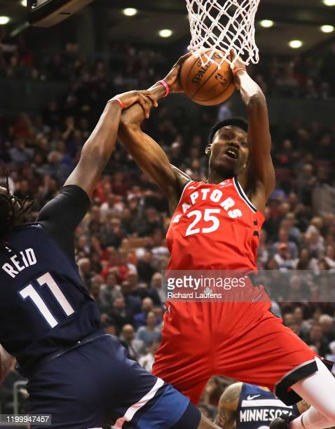 February 10 In the first half, Toronto Raptors forward Chris Boucher tries to get through Minnesota Timberwolves center Naz Reid to the hoop without...