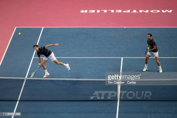 MONTPELLIER FRANCE February 10 Ivan Dodig of Croatia and Edouard RogerVasselin of France in action against Benjamin Bonzi of France and Antoine Hoang...