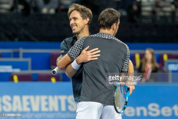 MONTPELLIER FRANCE February 10 Ivan Dodig of Croatia and Edouard RogerVasselin of France celebrate victory against Benjamin Bonzi of France and...
