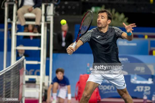 MONTPELLIER FRANCE February 10 Ivan Dodig of Croatia in action along with his partner Edouard RogerVasselin of France against Benjamin Bonzi of...