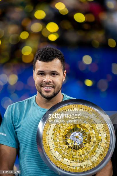 MONTPELLIER FRANCE February 10 JoWilfried Tsonga of France with the winners trophy after his victory against PierreHughes Herbert of France in the...