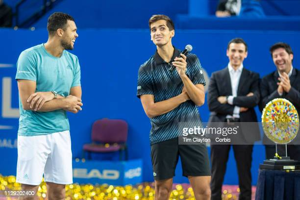 MONTPELLIER FRANCE February 10 PierreHughes Herbert of France compliments winner JoWilfried Tsonga of France during presentations after the Men's...